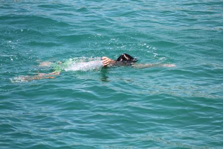 Drowning in the sea Archivio Fotografico