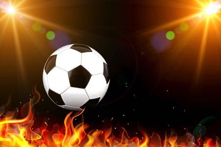 Soccer ball with stadium lights and flames Imagens