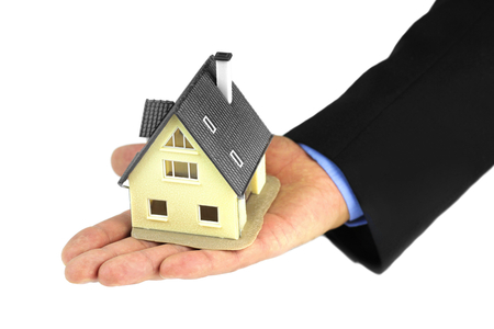 House in hands on white background. Stock Photo