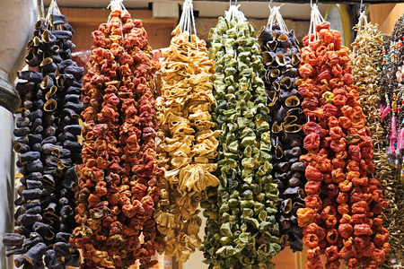 Sun dried eggplant and red peppers hanging to dry at spice Market in Turkey