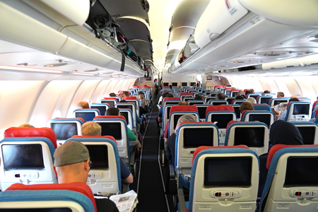 Airplane inside and passengers