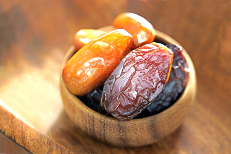 Ramadan iftar food, delicious date fruits  on wooden bowl.