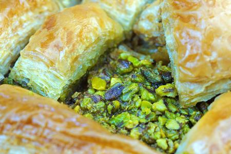 Delicious Turkish baklava with green pistachio nuts , macro shot 写真素材