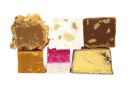 Various sweet confectionery fudge isolated on white background.