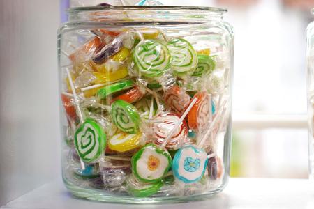 Colorful lollipops in jar 写真素材