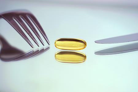 Fish oil capsule, omega 3, conceptual image.