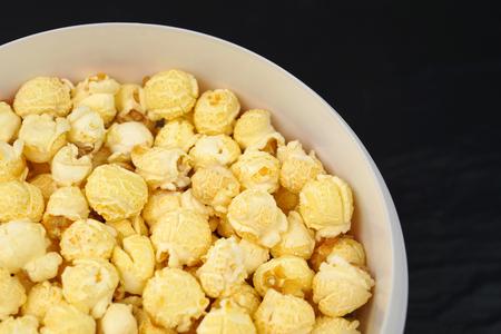 Caramelized popcorn on black background