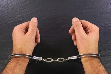 Hands in handcuffs 写真素材