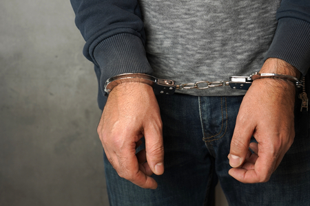 Hands of man and handcuffs 写真素材