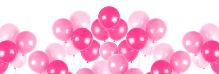 Pink party balloons on white background .