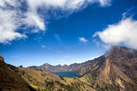 mountain view: Cloudy view of lake in the volcano mountain during the sunny day