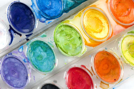 Rows of watercolor paints at a diagonal.