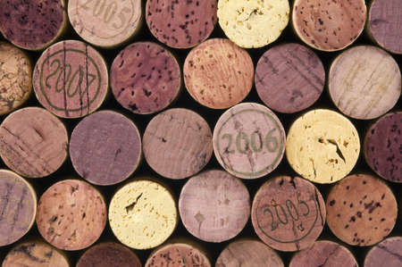 Stack of wine corks against black, shades of purple. Imagens