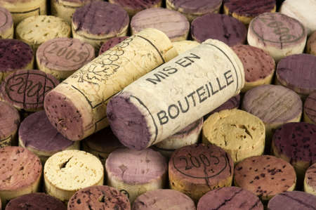 Mis en bouteille printed cork on a background of wine stoppers.
