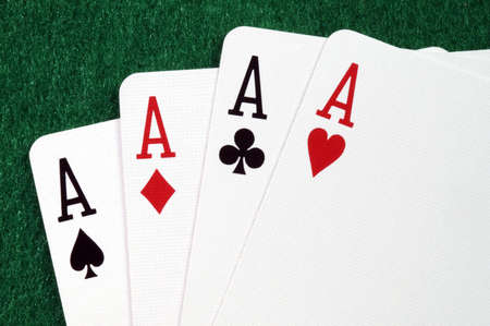 Four playing cards on the green casino table. Stock Photo
