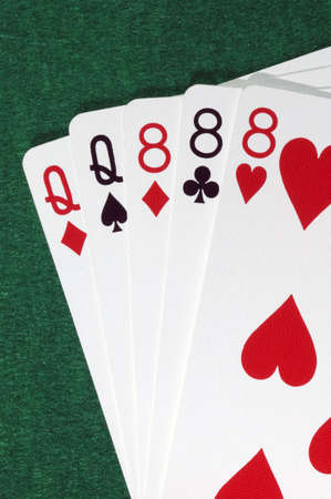 Poker hand, full house, queens and eights.