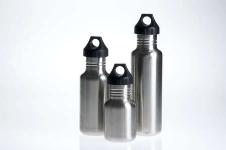 Three stainless steel water bottles of different sizes.