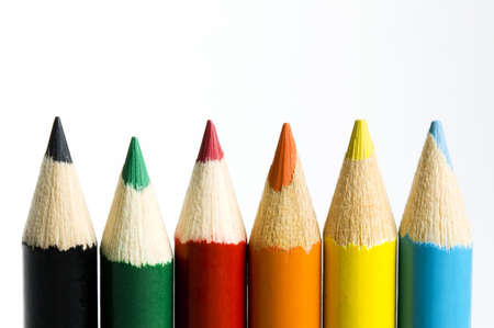 Six colored pencil points in a row along bottom of frame. Stok Fotoğraf