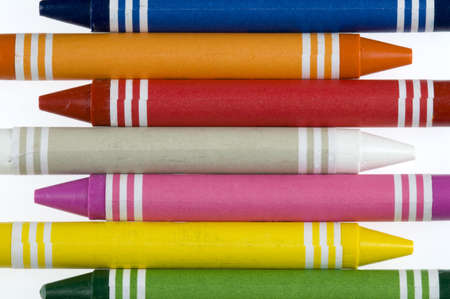 Seven crayons create a colorful background. Stok Fotoğraf