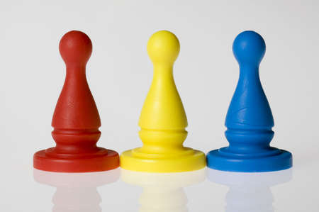 Three game pieces in a row, primary colors: red, yellow, and blue.