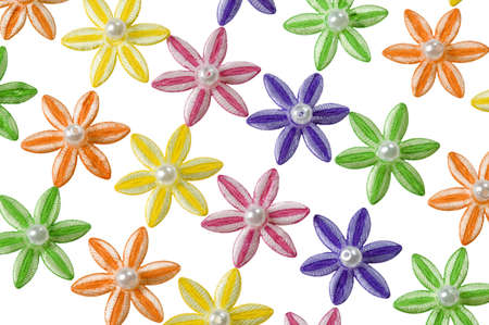 Background of yellow, orange, green, pink and purple applique flowers arranged in diagonal lines.