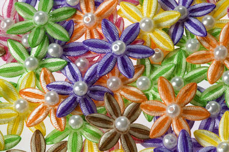 Full frame of brown, green, yellow, orange, pink, and purple applique flowers.