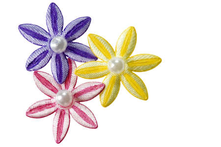Purple, pink, and yellow applique flowers isolated on a white background, could be used for business card or invitations.
