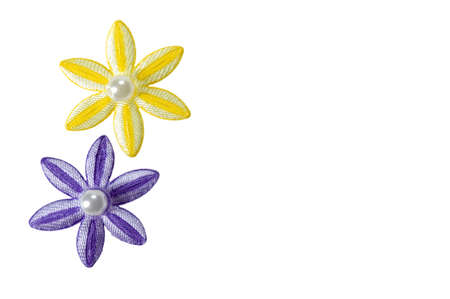 Purple and yellow applique flowers isolated on a white background, could be used for business card or invitations.