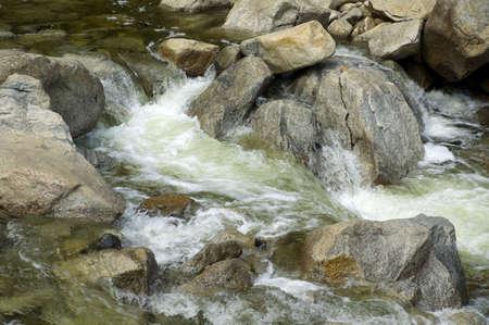 Water gushing over rocks in Yosemite National Park, California.