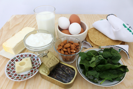 salad greens: rich in calcium, milk, salad greens, almonds, sardines Food 5 Stock Photo
