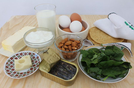 rich in calcium, milk, salad greens, almonds, sardines Food 2 Stock fotó - 53111270