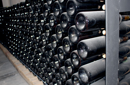 lactic: storage of bottles of wine and champagne in seasoning period Stock Photo