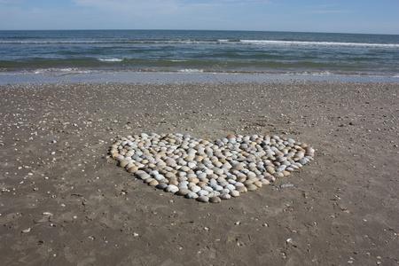 south padre: Seashell heart on beach Stock Photo