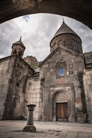 caved: The famous hermitage monastery Geghard, located in the mountains of Armenia Stock Photo