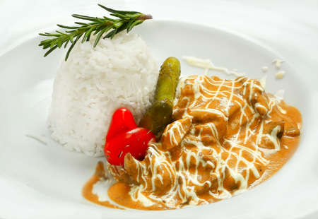 beef Stroganoff with rice. white background. Stock Photo