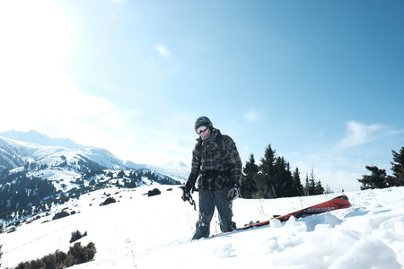 Freerider skier standing in the snow to the waist.
