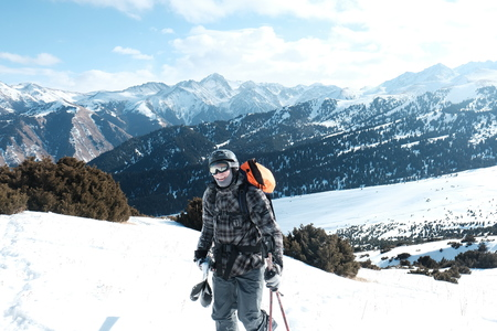 Freeride skis uphill backlit rising sun. 스톡 콘텐츠