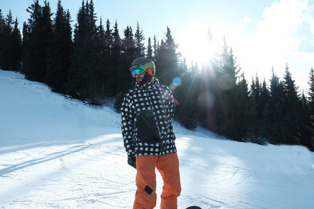 portrait of a snowboarder in a helmet and glasses