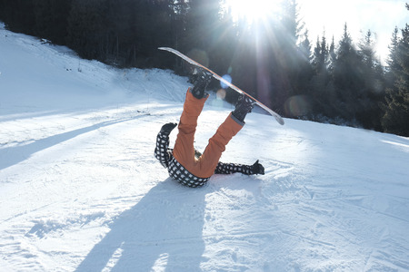 snowboarder with a board tumbles in the snow, 스톡 콘텐츠