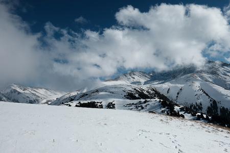 Snowy mountains. clear sky. Karakol. 스톡 콘텐츠