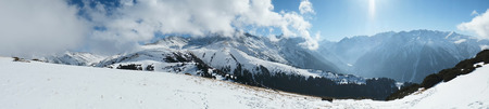 Panorama Snowy mountains. clear sky,