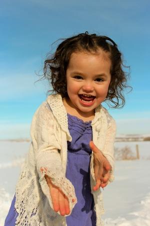 Adorable toddler girl playing outside photo