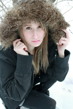 Beautiful woman outside during winter photo