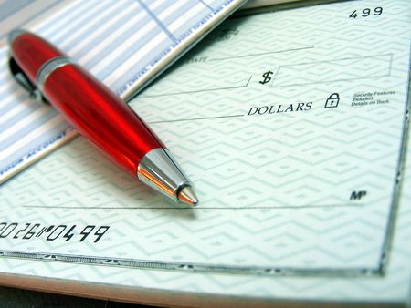 account executive: A red pen is on top of a blank check. Stock Photo