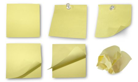 Five different yellow sticky notes available. One is crinkled up into a ball. Two have tacks in them. photo