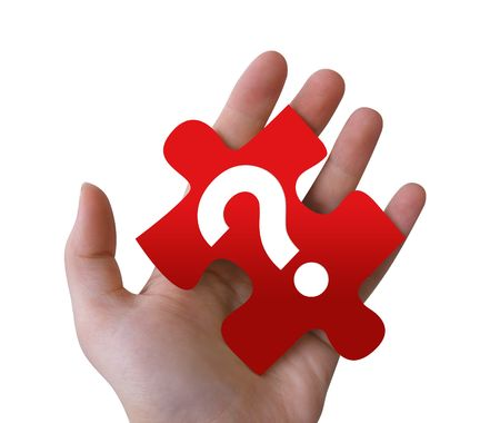 An isolated, Caucasian hand is holding a red puzzle piece with a question mark on it. Stock Photo - 4006907
