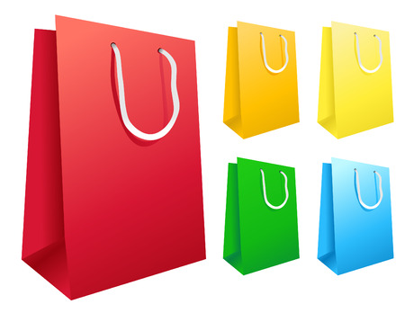 Colorful shopping bags are standing upright isolated on a white background.