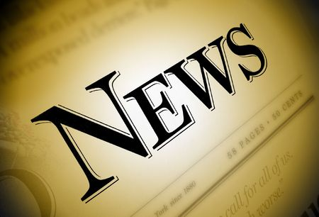 emphasized: A close-up of a newspaper with the word News emphasized in black on a browngold background.