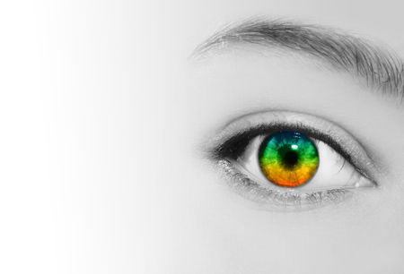 future vision: An extreme closeup of a womans eye which is in rainbow colors and her skin is in black and white.