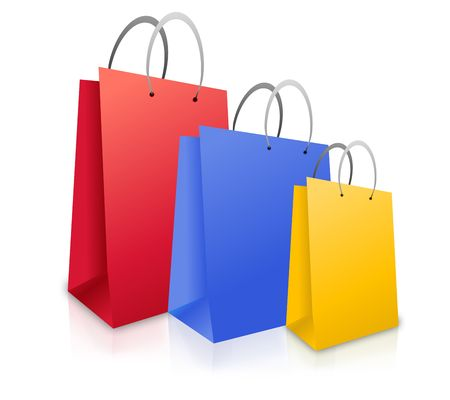 Three colorful shopping bags (red, blue and yellow) are standing upright on a white isolated background.